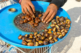 with a chill still in the air, the guys roasting chestnuts on the street were everywhere slow cooking these savory treats.