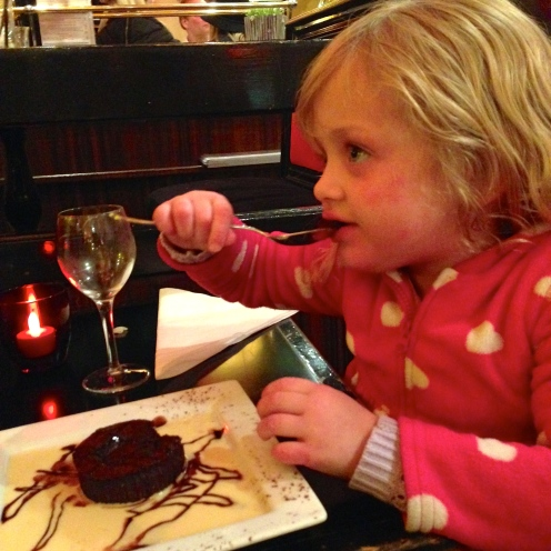 Miss Girl finally got her birthday treat: a fudgy, brownie-like chocolate cake drizzled in chocolate syrup and swimming in creme Anglaise. the stakes are high for 6.