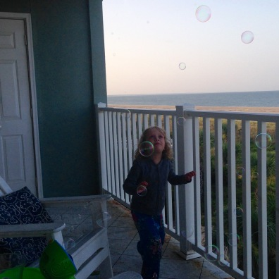 chasing bubbles at sunset