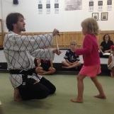 breaking boards like a boss at a martial arts birthday party.