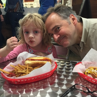 i think Daddy's just trying to steal my fries.