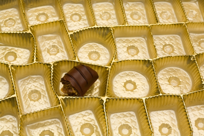 Closeup of a box of Chocolates with One Remaining Candy